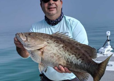 Captain_Jimmy_Bitzas_Holding_Grouper