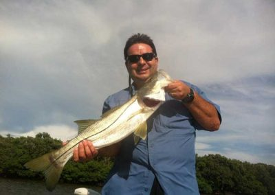 Captain_Jimmy_Bitzas_Holding_Snook