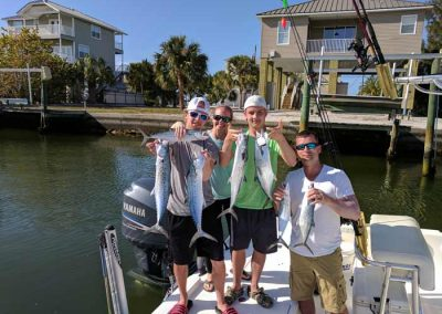Customers_Holding_Fish_After_JImmys_Fishing_Charters_Trip