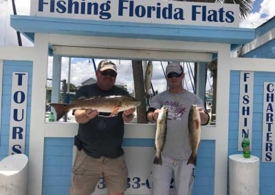Fishing_Florida_Flats_Customer_Holding_red_drum_fish