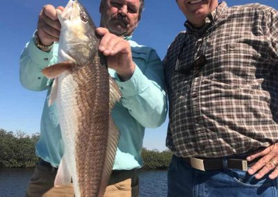Men_Holding_Red_Drum_Fish_Florida_Hudson
