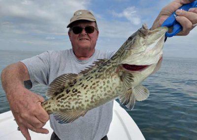 Older_Man_Holding_Gag_Grouper_Florida